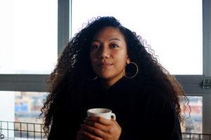 Mina Nau holds a coffee.